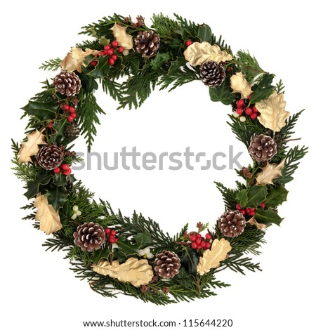 Christmas decorative wreath of natural and golden oak and holly, ivy, mistletoe, cedar leyland leaf sprigs, pine cones over white background. - stock photo