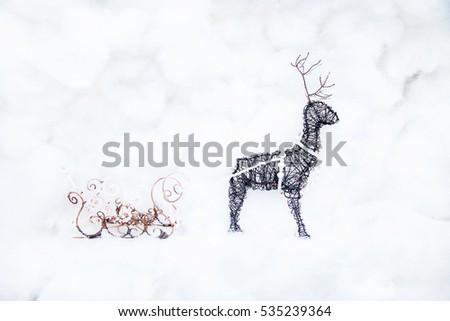 Christmas deer and sleigh made of copper wire and beads. Handmade Christmas decorations.