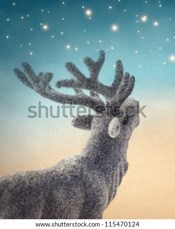 Christmas deer on blue background - stock photo