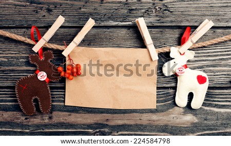 Christmas deers. Christmas decoration over wooden background  - stock photo