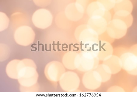 Christmas Defocused gold Bokeh light Vintage background. Elegant Abstract Christmas background with blur golden lights - stock photo