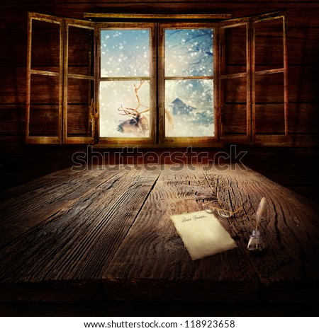 Christmas design - Dear Santa. Xmas winter background in wooden cabin with letter to Santa Clause, reindeer and winter landscape in the back. - stock photo