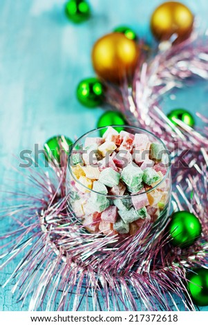 Christmas dessert turkish delight decorated with balls and tinsel - stock photo