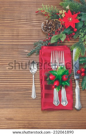 Christmas dinner. Christmas background with silverware and fir tree. A knife, spoon and two forks on a napkin on a textured tablecloth. Christmas vintage concept. Copy space for your text - stock photo
