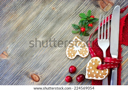 Christmas dinner decoration with gingerbread cookies sample text - stock photo