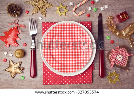 Christmas dinner plate setting with rustic decorations. View from above - stock photo