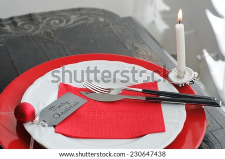Christmas Dinner Plate with Candle - stock photo