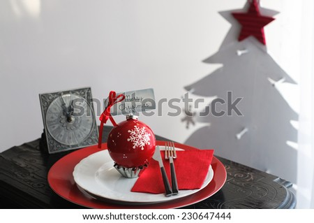 Christmas Dinner Plate with Vintage Clock and Christmas Tree - stock photo