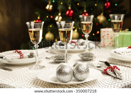 Christmas dinner table. Traditional Christmas decorations. Served table in a restaurant. Beautifully set table for Christmas Eve.