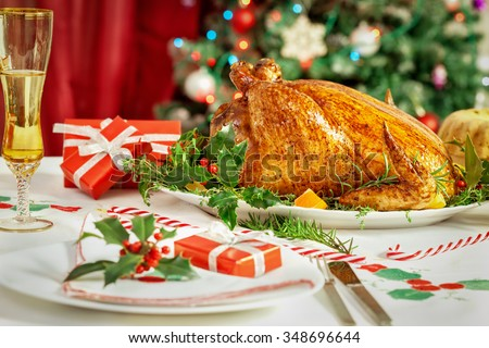 Christmas dinner table with Turkey and presents - stock photo