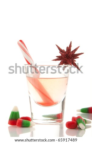 Christmas drink with cane and candies decorated with ornament on a white background - stock photo