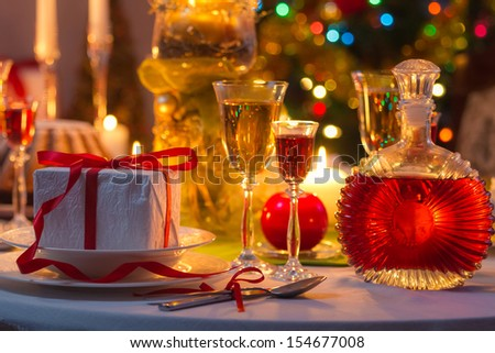 Christmas drinks and presents for long winter nights - stock photo