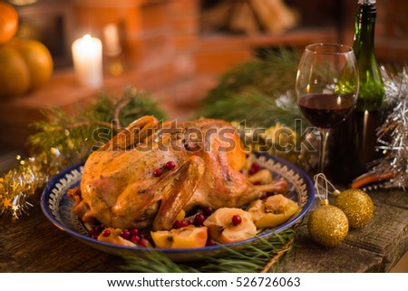 Christmas duck baked with apples and berry for dinner.