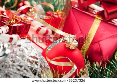Christmas eve abundance. Many holiday ornaments and gifts - stock photo