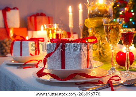 Christmas Eve dinner by candlelight - stock photo