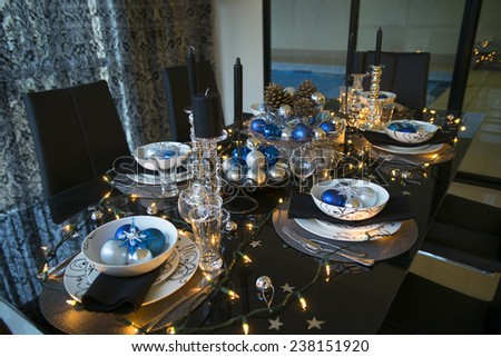 christmas eve table setting with ornament, new year eve table setting - stock photo