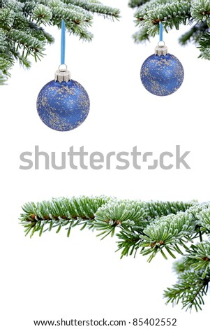 Christmas evergreen spruce tree and blue glass balls on snow background - stock photo