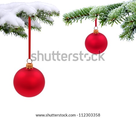Christmas evergreen spruce tree with glass ball on snow background - stock photo