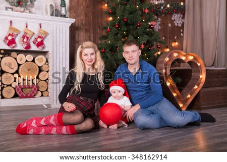 Christmas family of three persons happy smiling over night background on the roof - stock photo