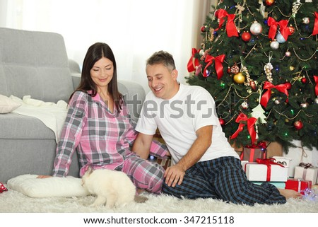 Christmas family portrait in home holiday living room, at morning