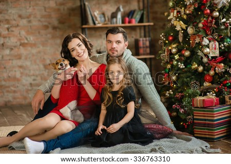 Christmas family portrait in home holiday living room kids and baby with present gift box