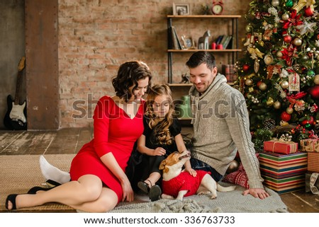 Christmas family portrait in home holiday living room kids and dog play present gift