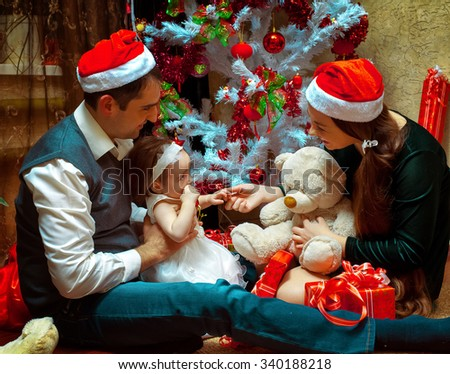 Christmas family with little baby girl. Christmas mood. New year. - stock photo