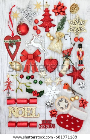 Christmas festive decorations with gold noel sign, old fashioned and new baubles, holly, mistletoe, fir and  mince pie on rustic white wood background.