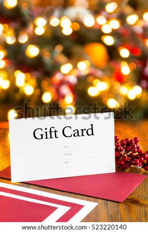 Christmas festive gift card voucher red stock photo royalty free christmas festive gift card voucher with red envelope on wooden table blurred lights background tree negle Choice Image