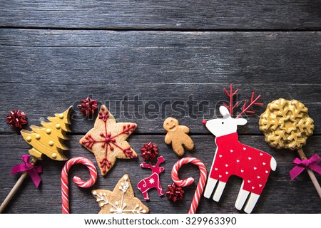 Christmas festive homemade decorated sweets on wooden background - stock photo