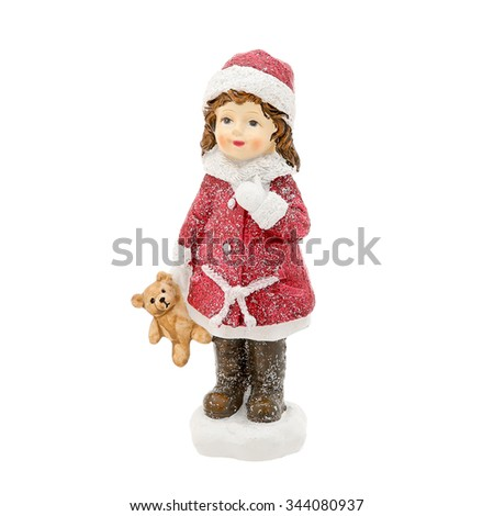Christmas figurine of a girl isolated on a white
