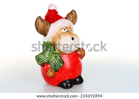 Christmas figurines,reindeer with Santa clause outfit - stock photo