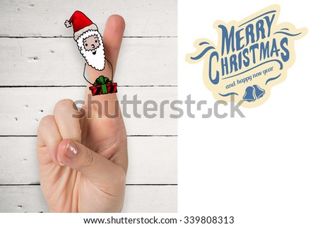 Christmas fingers against white background with vignette