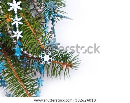 Christmas fir and blue decoration on white background, space for your text - stock photo