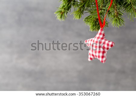 Christmas fir branch and decor, on the wooden background. - stock photo