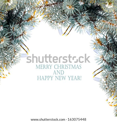 Christmas fir branch with gold streamers and stars on a white background isolated - stock photo