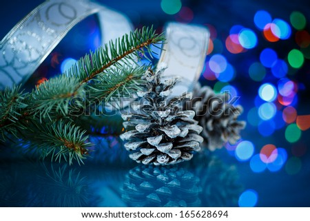 Christmas fir cones on a blue background