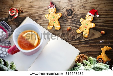 Christmas fir tree and notepad with decoration on dark wooden board. Top view with copy space