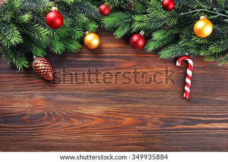 Christmas fir tree branches with toys on wooden table