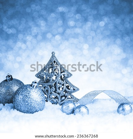 christmas fir tree decoration on glitter background - stock photo