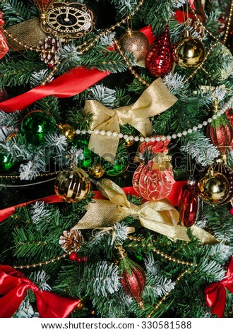 Christmas fir-tree is decorated with toys - stock photo