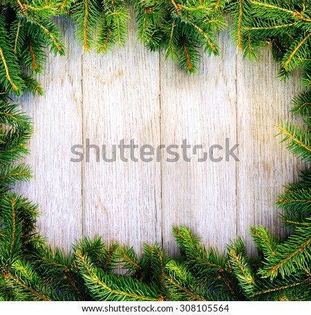 Christmas fir tree on a wooden board. Natural frame. - stock photo