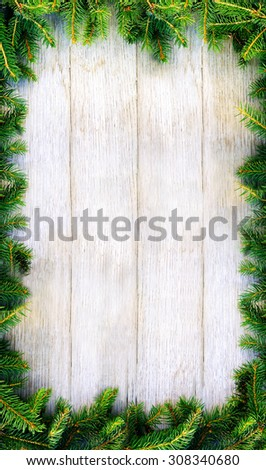 Christmas fir tree on a wooden board. Perfect background for Christmas and New Year holidays. - stock photo
