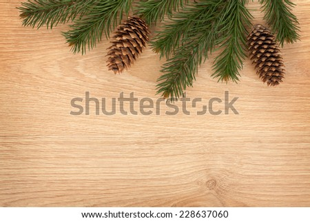 Christmas fir tree on wooden board background - stock photo