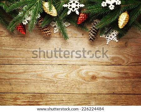 Christmas fir tree on wooden board background with copy space  - stock photo
