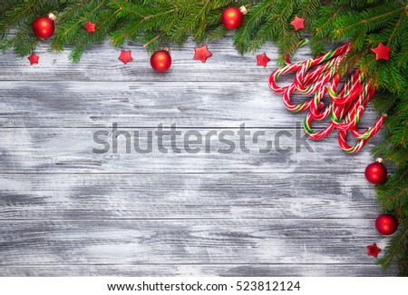 Christmas fir tree on wooden grunge background