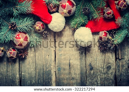 Christmas Fir Tree Toys, Santa's hat, Spruce as Decoration on Wooden Background. Toned - stock photo