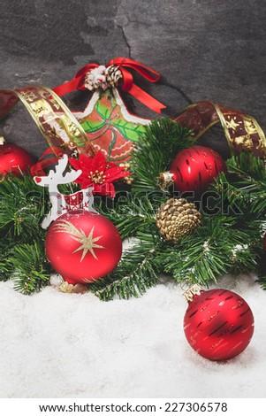 Christmas fir tree with christmas decoration. Gold And Red Christmas Decorations. Done with a vintage retro filter. Macro, selective focus - stock photo