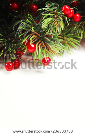 Christmas fir tree with decoration isolated on white background