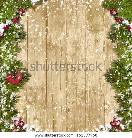 Christmas fir tree with decoration on a wooden board  - stock photo